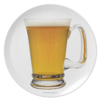 Close up of a glass of beer 2 plate
