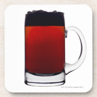 Close up of a glass of beer beverage coaster