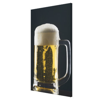Close-up of a glass of beer canvas print