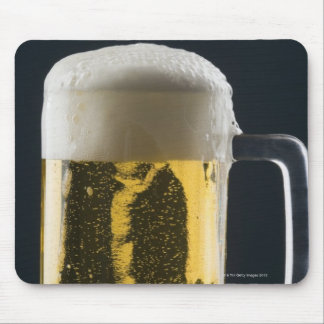 Close-up of a glass of beer mousepads
