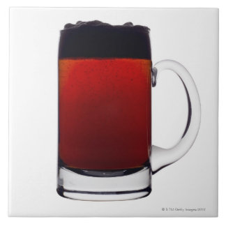 Close up of a glass of beer large square tile