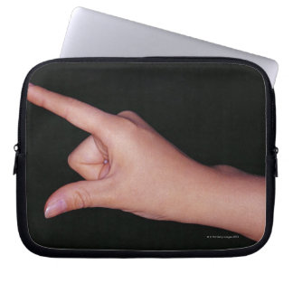 Close-up of a hand with finger and thumb laptop sleeve