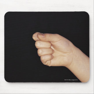 Close-up of a hand with fist clenched mouse pad