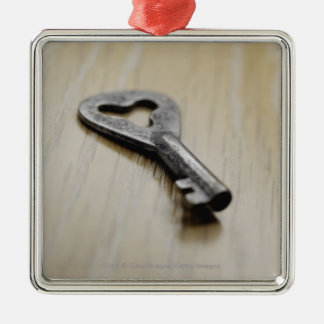Close-up of a key square metal christmas ornament