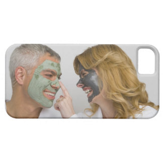 Close-up of a mature couple wearing facial masks iPhone 5 covers