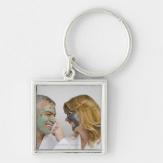 Close-up of a mature couple wearing facial masks keychain
