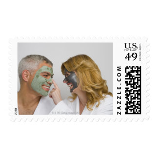 Close-up of a mature couple wearing facial masks postage stamp