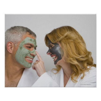 Close-up of a mature couple wearing facial masks poster
