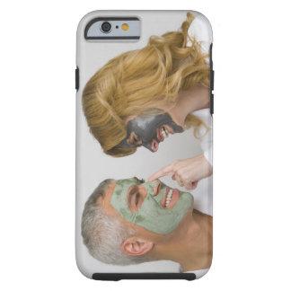 Close-up of a mature couple wearing facial masks tough iPhone 6 case