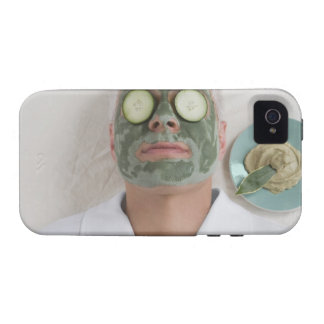 Close-up of a mature man lying down with a face case for the iPhone 4