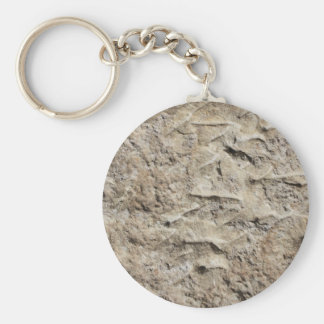Close up of a mill stone keychain