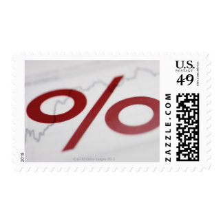 Close-up of a percentage sign on a line graph postage