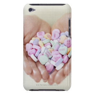 Close-up of a Person Holding a Pile of iPod Touch Case-Mate Case
