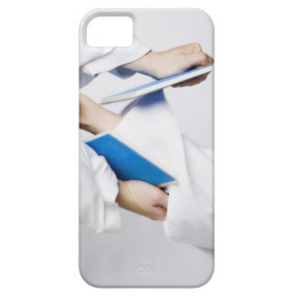 Close-up of a person's leg breaking a tile iPhone 5 cover