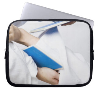 Close-up of a person's leg breaking a tile laptop computer sleeves