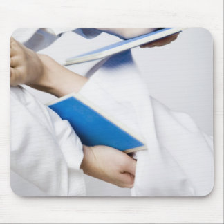 Close-up of a person's leg breaking a tile mouse pad