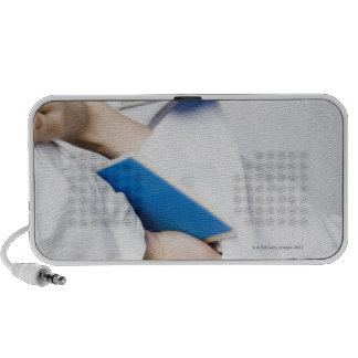 Close-up of a person's leg breaking a tile iPhone speaker