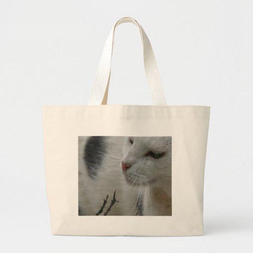 Close Up Of A Piebald Cat Tote Bags