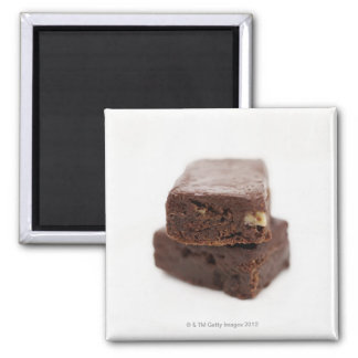 Close-up of a pile of two chocolate brownies on fridge magnet