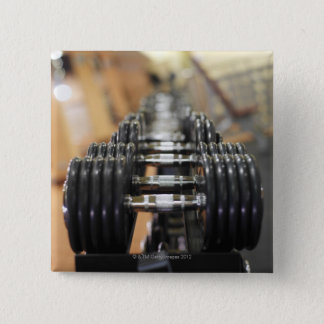 Close-up of a row of dumbbells button