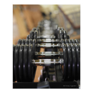 Close-up of a row of dumbbells poster