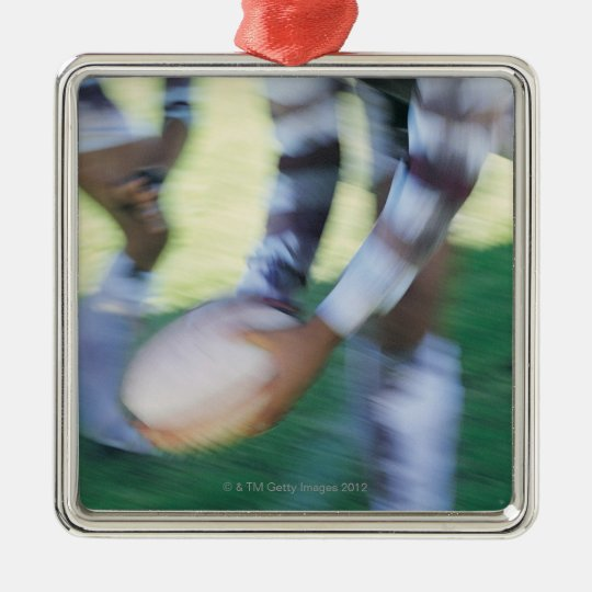 Close up of a Rugby Union Player Passing The Metal Ornament
