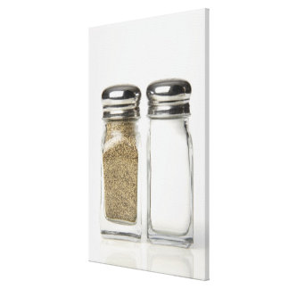 Close-up of a salt and a pepper shaker 2 canvas print