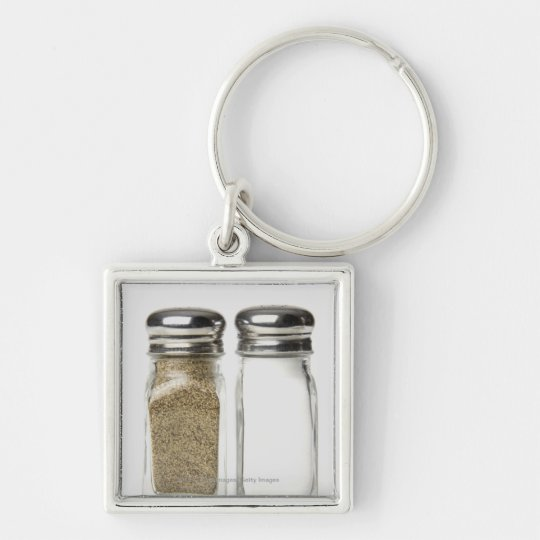 Close-up of a salt and a pepper shaker keychain