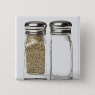 Close-up of a salt and a pepper shaker pinback button