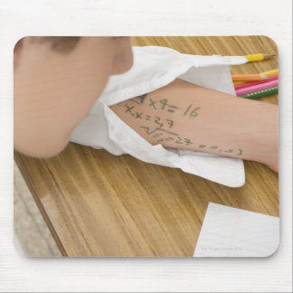 Close-up of a schoolboy copying in an mouse pad