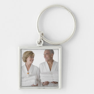 Close-up of a senior man with a mature woman keychains