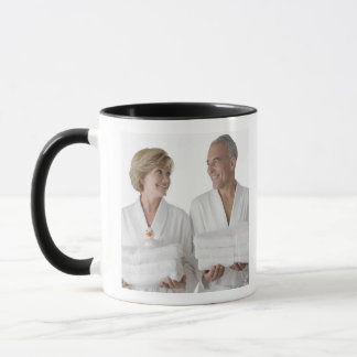 Close-up of a senior man with a mature woman mug