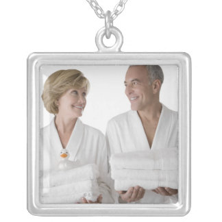 Close-up of a senior man with a mature woman silver plated necklace