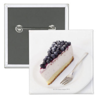 Close-up of a slice of blueberry cheese cake pins