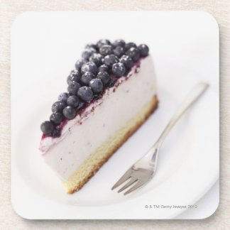 Close-up of a slice of blueberry cheese cake coasters
