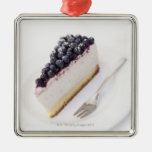 Close-up of a slice of blueberry cheese cake metal ornament