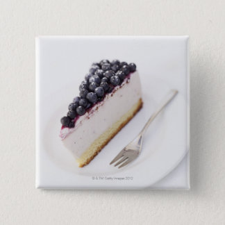 Close-up of a slice of blueberry cheese cake pinback button