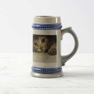 Close up of a tabby cats eyes beer stein