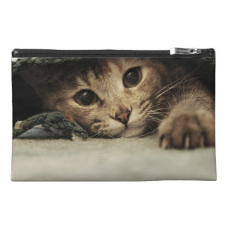 Close up of a tabby cats eyes travel accessory bag