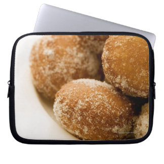 Close-up of a tray of a baked sugar coated laptop computer sleeves