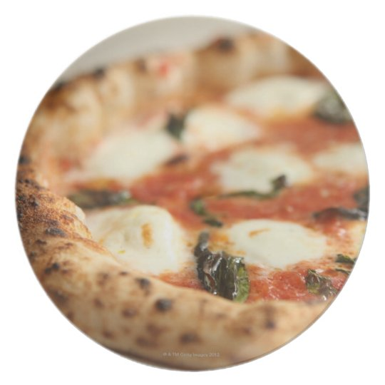Close-up of a whole pizza pie dinner plate