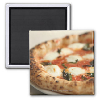 Close-up of a whole pizza pie magnet