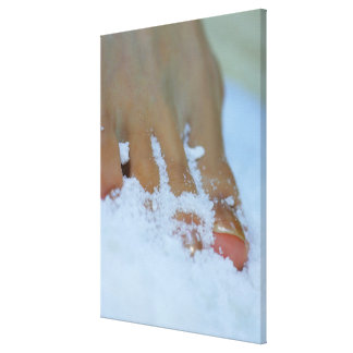 Close-up of a woman's foot in salt canvas print