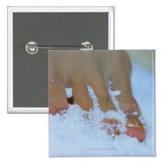 Close-up of a woman's foot in salt pinback button