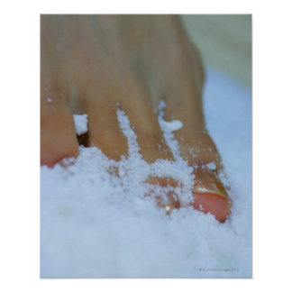 Close-up of a woman's foot in salt poster