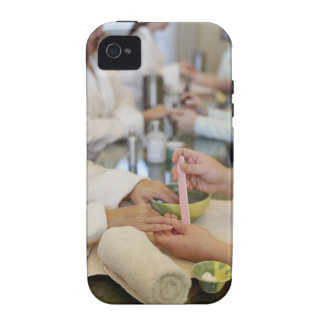 Close-up of a woman's hand getting a manicure vibe iPhone 4 covers