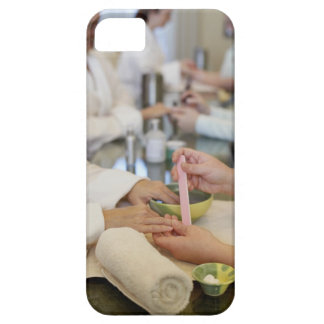 Close-up of a woman's hand getting a manicure iPhone 5 cases