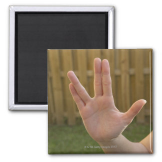 Close-up of a woman's hand making a hand sign 2 inch square magnet