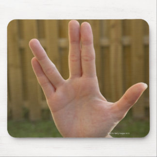 Close-up of a woman's hand making a hand sign mouse pad