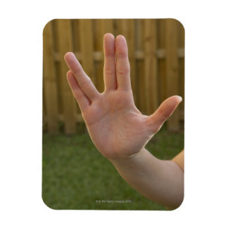 Close-up of a woman's hand making a hand sign rectangular photo magnet